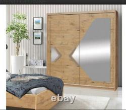 2 Door Sliding Wardrobe. Alder Lancelot/Grey Gloss/Mirror-150cmDN4-150. DOMINO. NEW