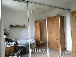4 x mirrored sliding doors. White frame