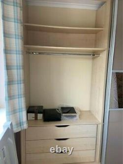 Fitted wardrobes with two sliding doors in beige and mirror finish rarely used