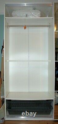 IKEA Pax double wardrobe with internal fittings, mirror sliding doors, white car