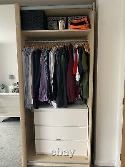 Large Oak Effect And Mirror Sliding Door Wardrobes