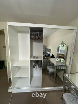 White mirrored sliding two door wardrobe